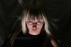 Witch portrait. Young girl-witch portrait look with threat Stock Photos