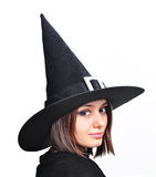 Witch portrait. Portrait of a teenager girl, with a witch hat stock photo