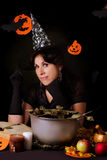 Witch practicing sorcery at Halloween night. Nice witch practicing sorcery at Halloween night Royalty Free Stock Images