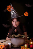 Witch practicing sorcery at Halloween night. Nice witch practicing sorcery at Halloween night Stock Images