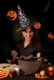Witch practicing sorcery at Halloween night. Smiling witch practicing sorcery at Halloween night Stock Photo