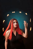 Witch practises witchcraft on black background. royalty free stock images