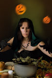 Witch practising sorcery at Halloween. Night Stock Photo