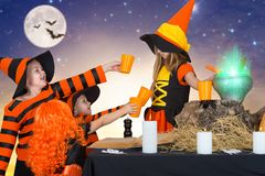 Halloween.The witch prepares a potion and bring your friends. royalty free stock photography