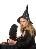 Witch preparing a potion Stock Images