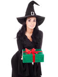 Witch with a present Stock Images