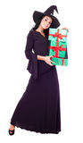 Witch with presents Royalty Free Stock Photo