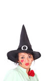 Witch. Pretty young witch on the blue background Royalty Free Stock Photography