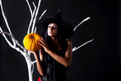 Witch with a pumpkin Stock Image