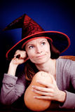 Witch with pumpkin Stock Photography
