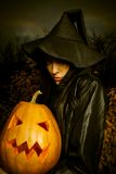 Witch with pumpkin Stock Image