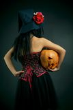 Witch with pumpkin Royalty Free Stock Photography