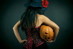 Witch with pumpkin Stock Images