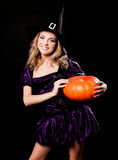 Witch with  a pumpkin Stock Photo