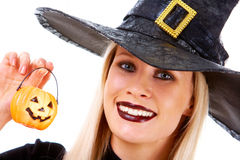 Witch with pumpkin candle Royalty Free Stock Image