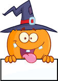 Witch Pumpkin Character Over A Blank Sign Stock Images