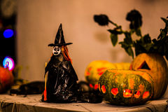 Witch and pumpkin. Glowing with colors Royalty Free Stock Photo