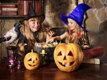 Witch  with pumpkin lantern. Royalty Free Stock Image