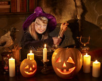 Witch  with pumpkin lantern. Royalty Free Stock Images