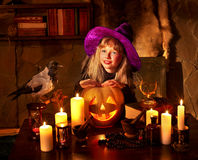 Witch  with pumpkin lantern. Stock Image