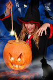 Witch with pumpkin Royalty Free Stock Photos