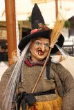 Witch puppet with a malicious smile. On his face Stock Photos