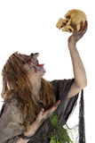Witch raises skull in the air Royalty Free Stock Photos