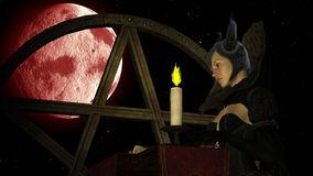 Witch reading Magic book with Candle light at Red Moon background with Pentacle Stock Images