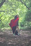 Witch in a red cloak among the. Forest halloween. escape attractive girl halloween magic and magic. a spell and a rite among the forest royalty free stock image