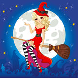 Witch In Red Dress Fly On Broom Stock Photo
