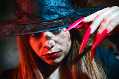 Witch with red nails Royalty Free Stock Image
