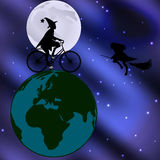 Witch riding a bicycle across the globe on a moonlit night Royalty Free Stock Image