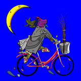 Witch riding a bicycle Royalty Free Stock Images
