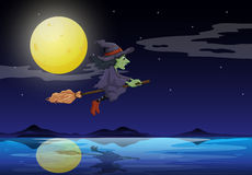 A witch riding on a broom travelling in the middle of the night Stock Photos