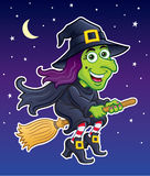 Witch Riding Her Broom In A Night Sky Royalty Free Stock Photos