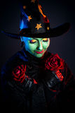 Witch with rose stock image