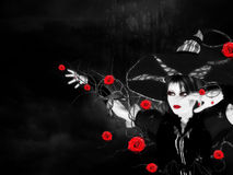 Witch with roses Royalty Free Stock Photography
