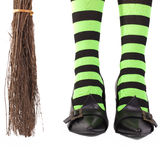 Witch's legs and broomstick. Royalty Free Stock Photos