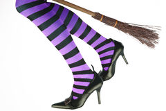 Witch's legs flying on a broomstick Royalty Free Stock Photo
