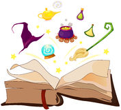 Witchs stuff floating on the magic book Royalty Free Stock Image