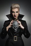Witch with a scull. Picture of a Witch with a scull Stock Photos