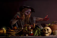 Witch shows her witch kitchen Royalty Free Stock Photo
