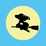 Witch silhouette on a moon background. Stock Image