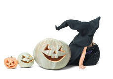 Witch sits in line with pumpkins Stock Photography