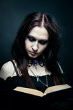 Witch with spell book Stock Photography