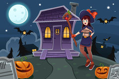 Witch Standing in Front of House Royalty Free Stock Image
