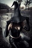 Witch stones. Witch with hat sitting on the stones Stock Images