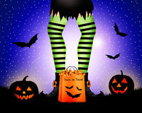 Witch with striped stockings Royalty Free Stock Photo