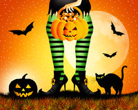 Witch with striped stockings Royalty Free Stock Photos