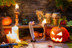 Witch table with halloween pumpkin Stock Photos